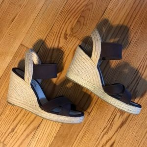 Brown fabric wedge espadrille sandals.